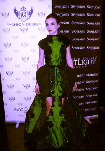 Our Logo Design on Stage for Alina G. Queen  - Talented Fashion Designer